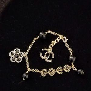 Auth chanel black beaded gold bracelet